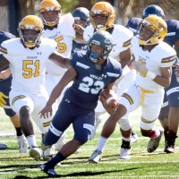 Wolverines Run Past TCNJ With 62-0 Opening Conference Game Win