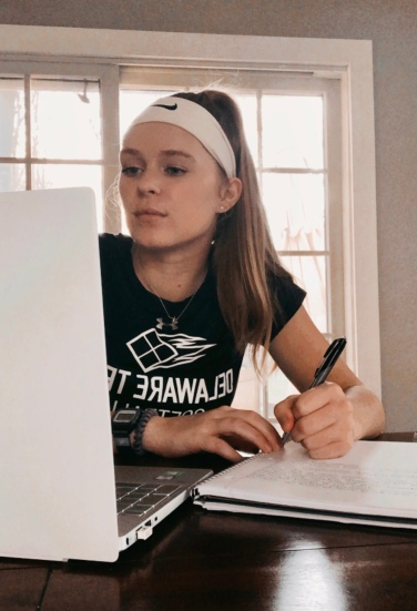 Softball player Kaylie Moore studying at home